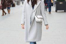 With midi coat, beanie with fur pom pom, cuffed jeans and crossbody bag
