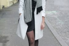 With mini dress, ankle boots and black and white scarf