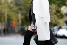 With mini dress, black over the knee boots and big bag