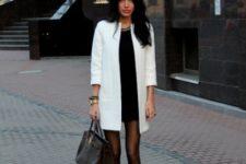 With mini dress, black platform shoes and big bag