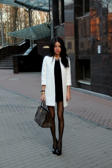 With mini dress, black platform shoes and big bag