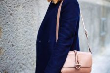 With navy blue beanie and light pink crossbody bag