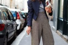 With navy blue jacket, gray shirt and white clutch