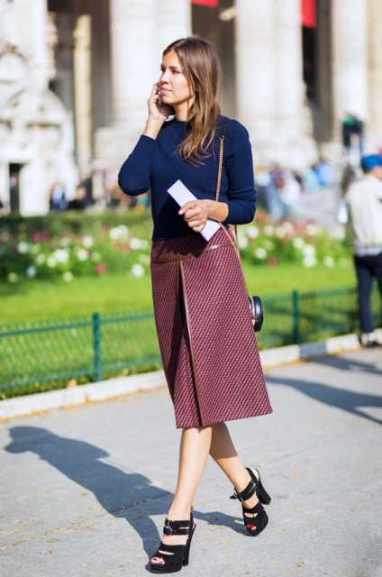 With navy blue sweater and high heels