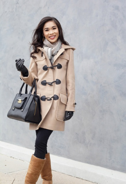 With neutral scarf, brown boots and big bag