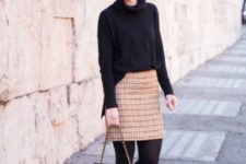 With oversized black sweater, black tights and ankle boots