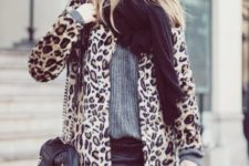 With oversized scarf, gray sweater and leather black mini skirt