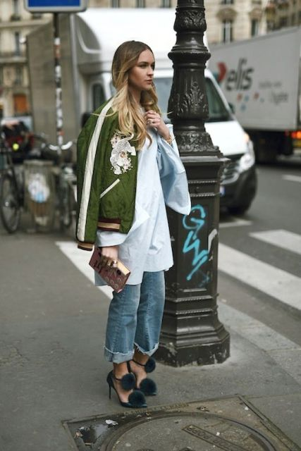 With oversized shirt, cuffed jeans and heels