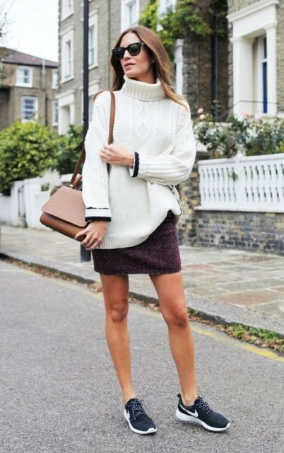 With oversized sweater and sneakers