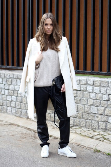 With oversized sweater, loose pants and white sneakers