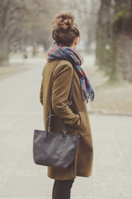 With plaid scarf and big bag