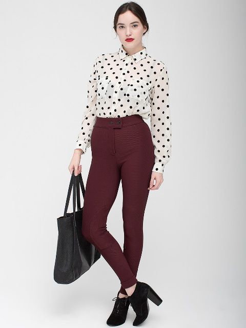 With polka dot shirt, big bag and suede boots