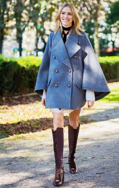 With poncho coat and white mini dress
