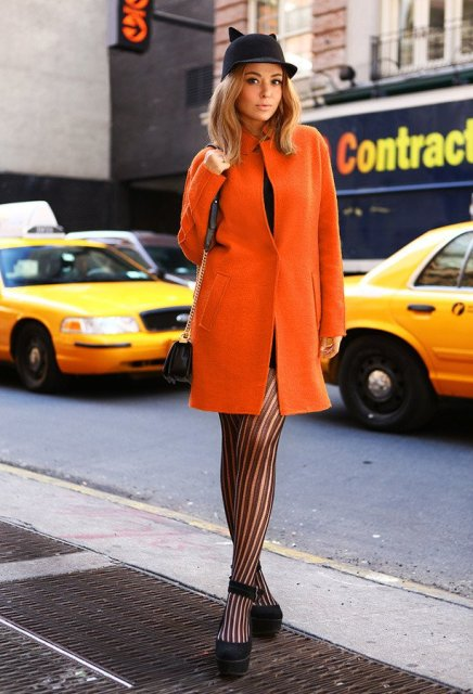 With printed tights, platform shoes and original hat