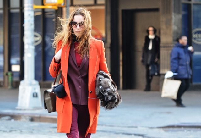 With red shirt, purple jacket and trousers, neutral bag