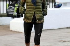 With scarf, sporty leggings and sneakers
