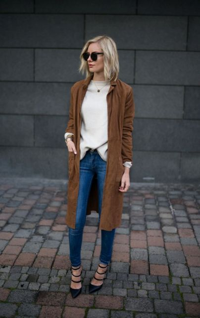 With silk blouse, skinny jeans and lace up heels