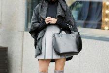With skater skirt, wide brim hat, gray coat and black bag