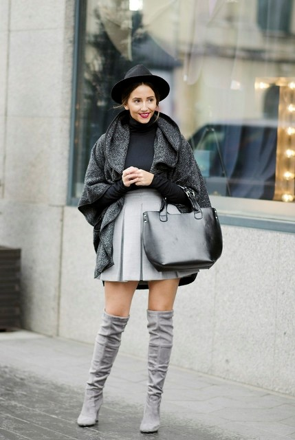 With skater skirt, wide brim hat, gray coat and black bag