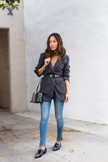 With skinny jeans, lace up shoes and embellished bag