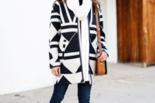 With skinny jeans, printed ankle boots, white oversized scarf and leather bag
