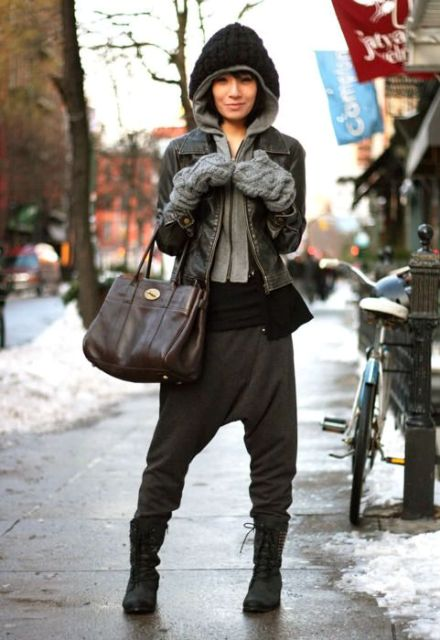 With sport pants, jacket and big bag