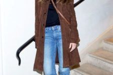 With straight jeans, leather boots and crossbody bag