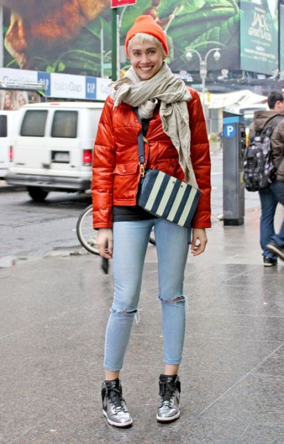 With striped bag, crop jeans and metallic boots
