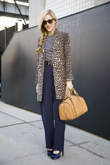 With striped shirt, blue trousers and platform shoes