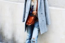 With striped shirt, distressed jeans and red bag
