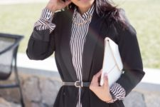 With striped shirt, jeans and white clutch