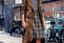 With striped shirt, plaid skirt and black shoes