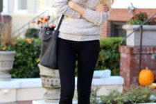 With sweater, black pants and socks