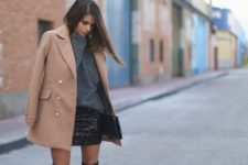 With sweatshirt, bright skirt and over the knee boots