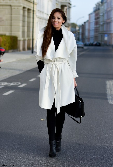 With turtleneck, skinnies and ankle boots