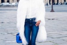 With white blouse, crop jeans and blue bag and boots