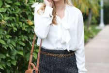 With white blouse, leopard belt and small bag