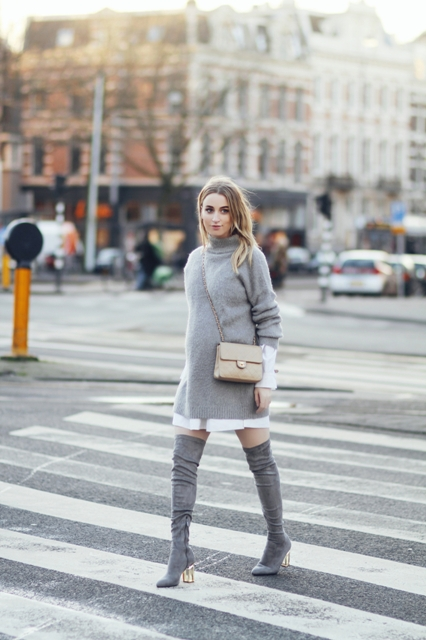 With white dress, gray oversized sweater and crossbody bag
