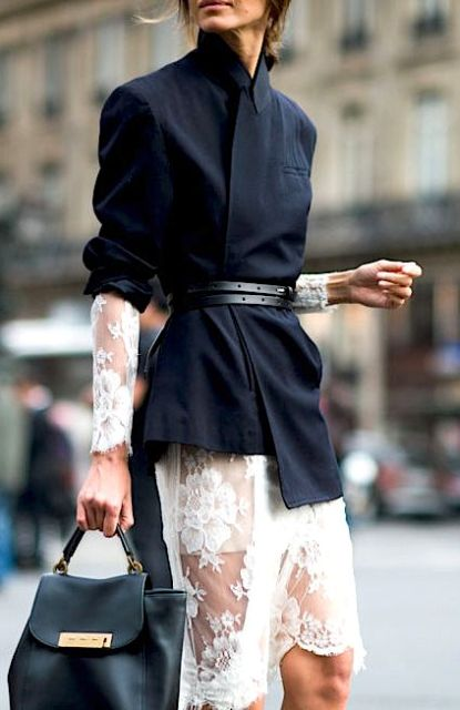 With white lace dress and leather bag