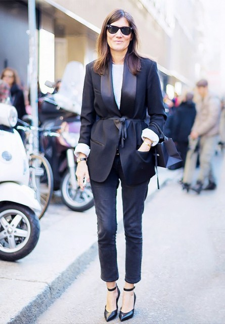 With white shirt, cropped pants and heels