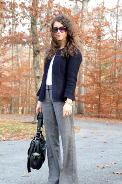 With white shirt, navy blue jacket and black bag