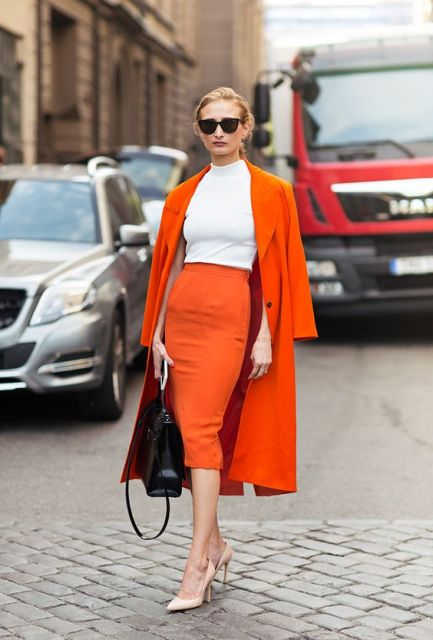 With white shirt, orange pencil skirt and neutral pumps