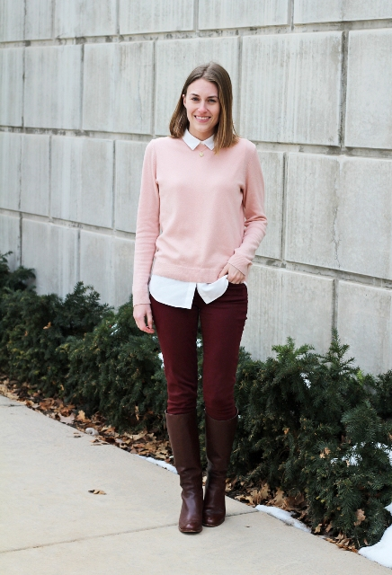 With white shirt, pink sweater and brown boots