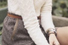 With white sweater and statement necklace