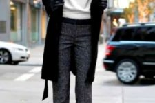 With white sweater, black coat and pumps