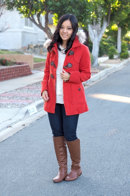 With white sweater, jeans and brown high boots