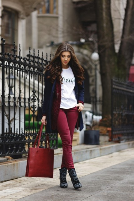 With white t-shirt, navy blue coat and red bag