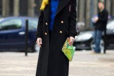 With yellow scarf, blue shirt, pants, pumps and eye-catching clutch