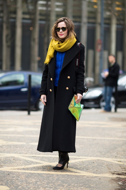 With yellow scarf, blue shirt, pants, pumps and eye catching clutch