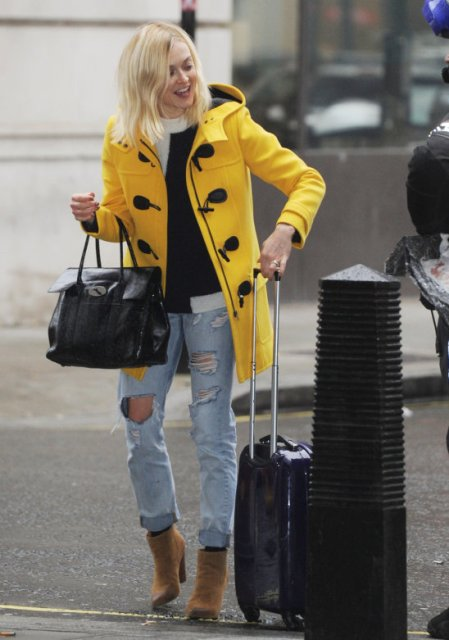 Yellow coat with distressed jeans, brown heeled ankle boots and black bag